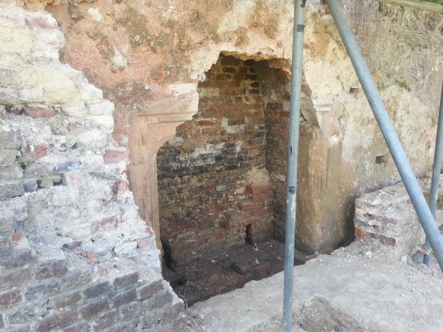Holes to fix wooden panels in place, can be seen in the walls surround the fireplace.