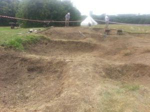 The trenches from the 1960s excavation are becoming visible.